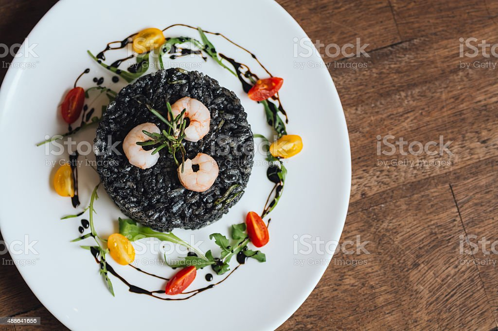 Overhead view of black risotto royalty-free stock photo