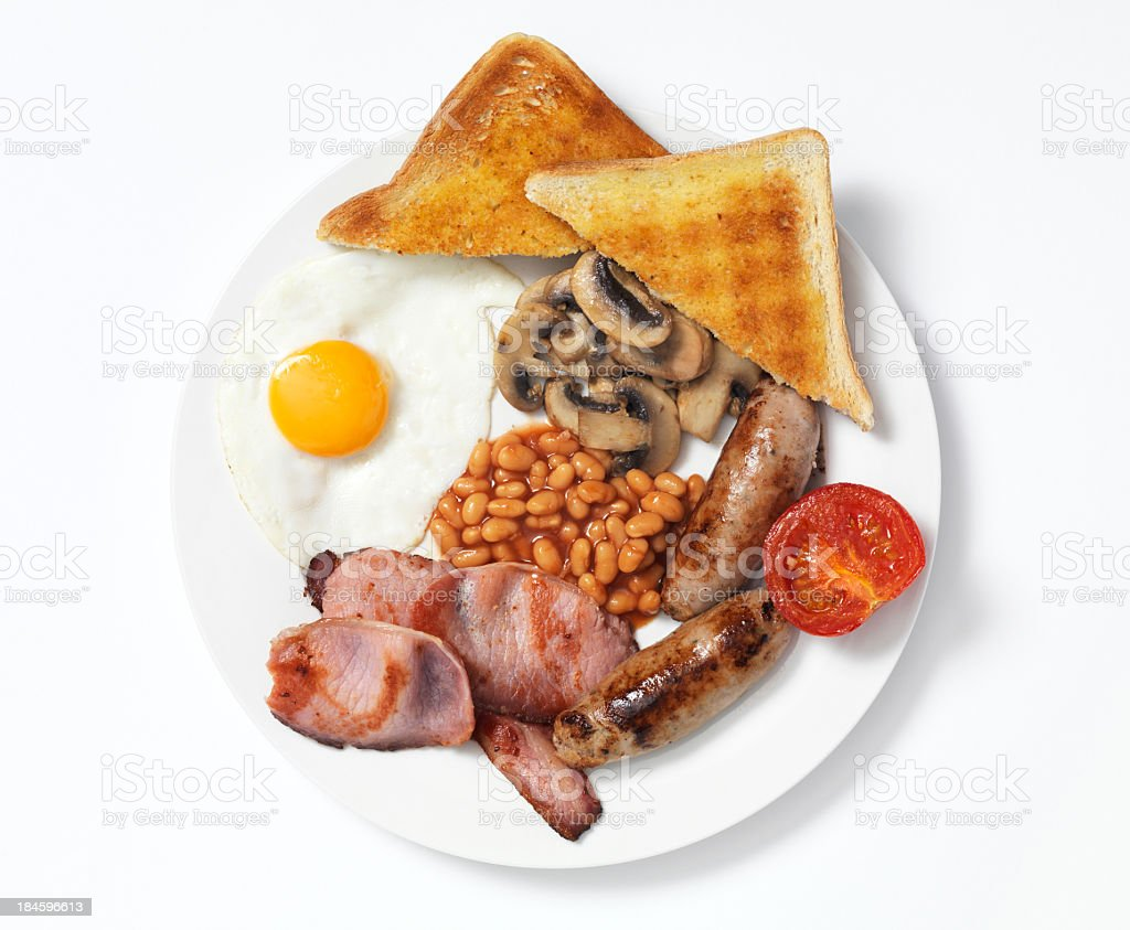 Overhead view of breakfast with meat, beans, eggs and toast stock photo