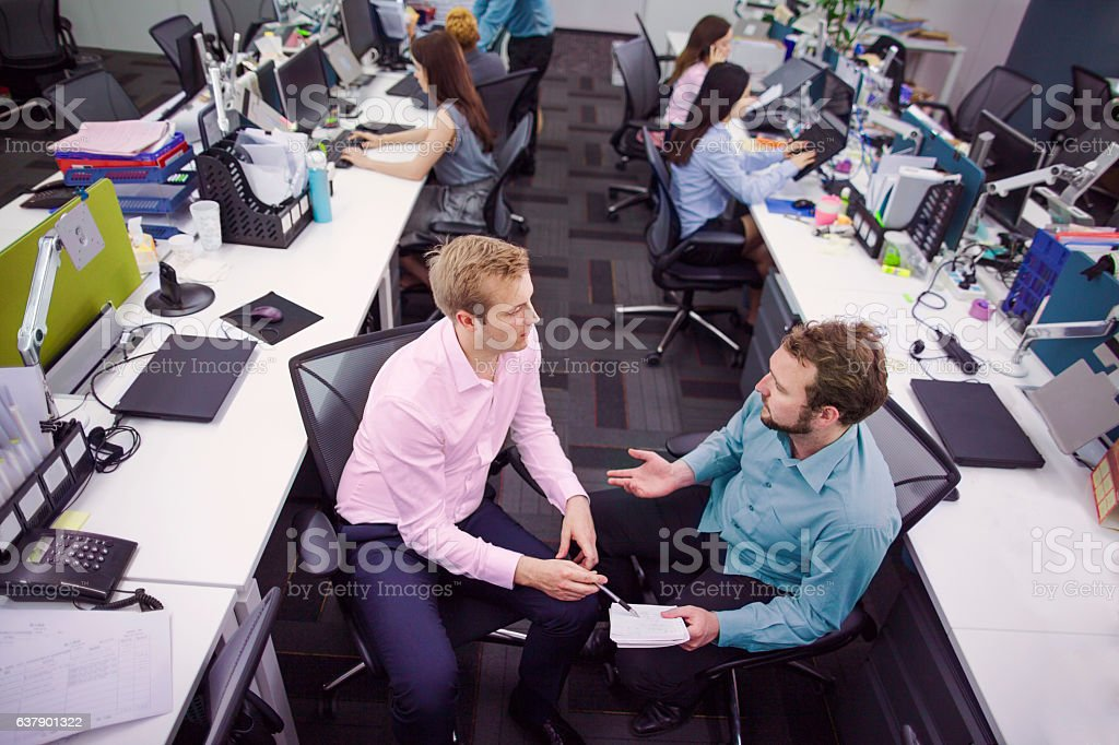 Overhead view of business colleagues talking in office stock photo