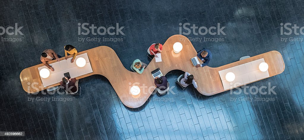 Overhead view of business meetings stock photo