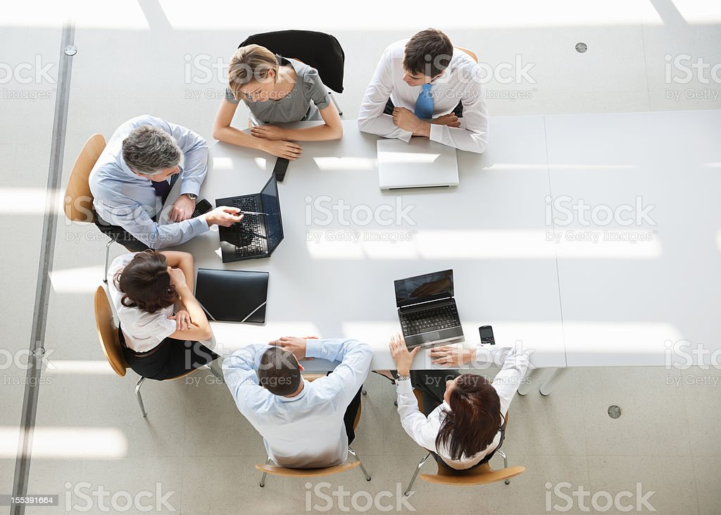 Overhead view of business people in a meeting stock photo