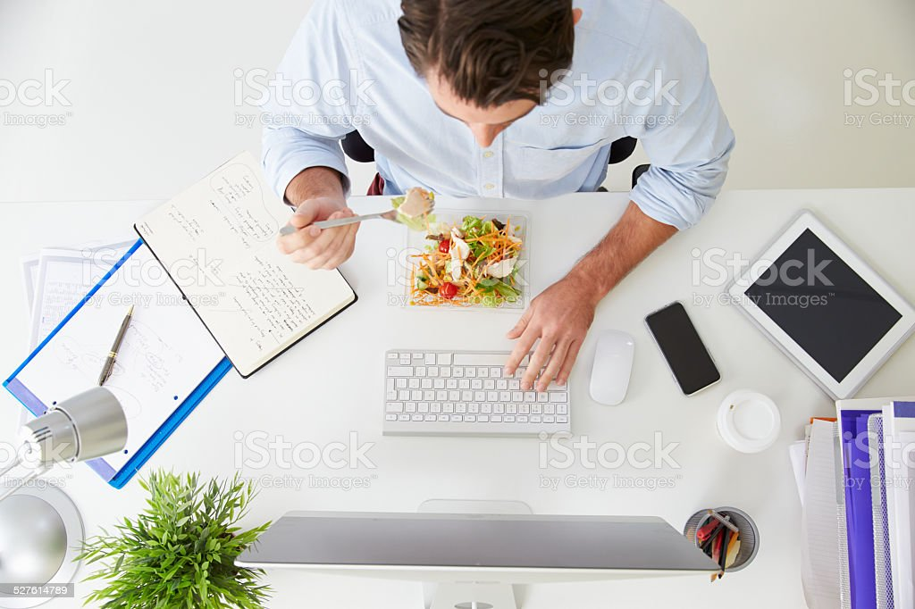 Overhead View Of Businessman Working At Computer In Office stock photo
