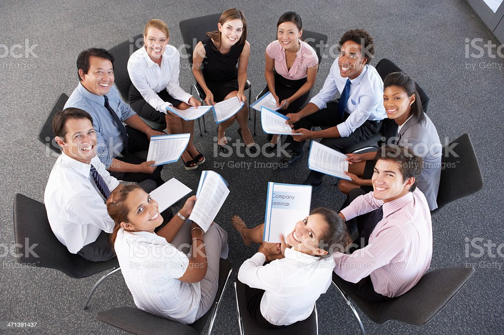 Overhead View Of Businesspeople Seated In Circle At Company Semi royalty-free stock photo