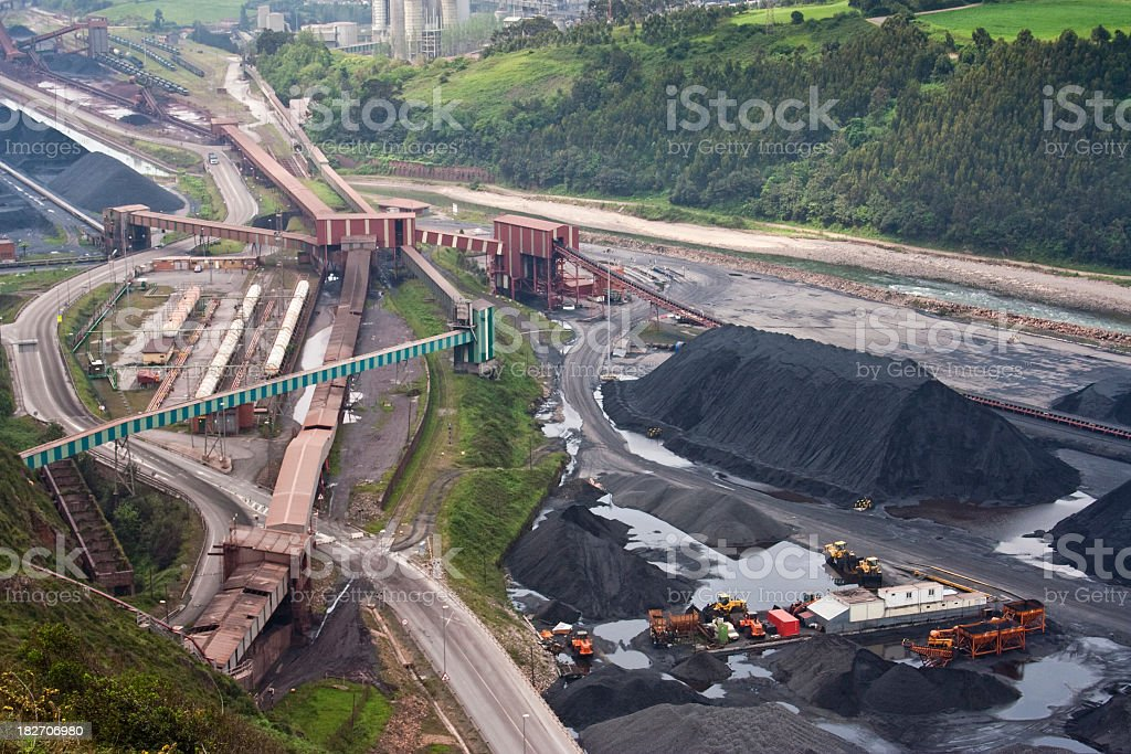 Overhead view of busy coal mining site equipment facility stock photo