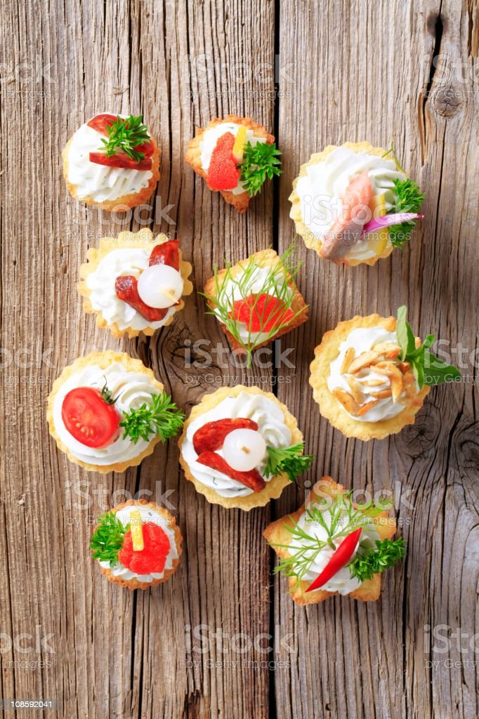 Overhead view of canapes on a wooden table royalty-free stock photo