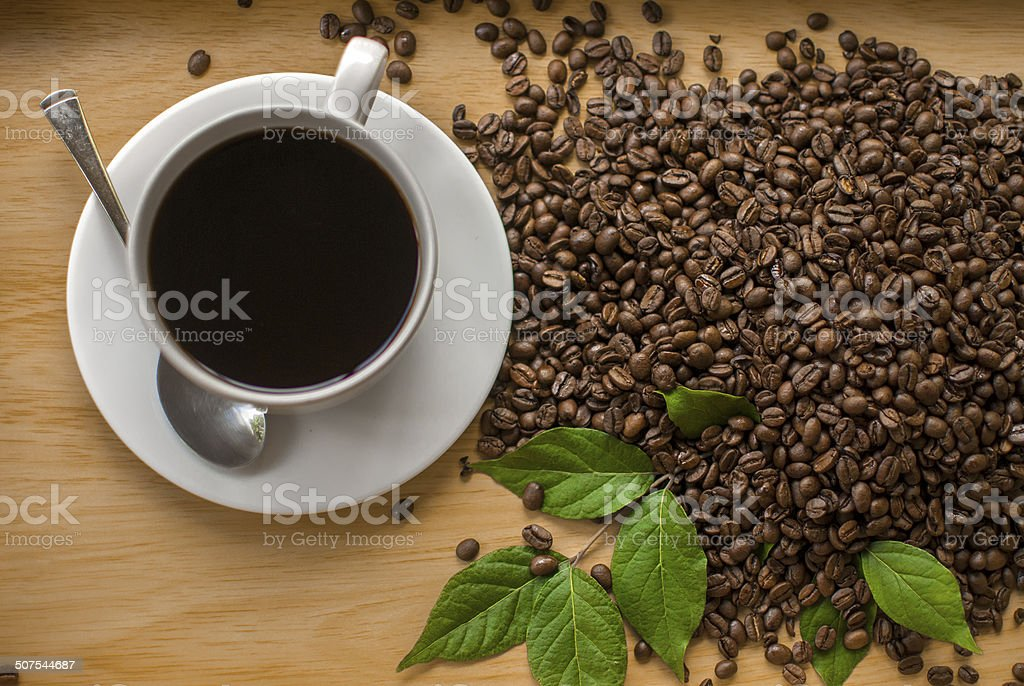 Overhead view of Coffee and beans with leaves stock photo