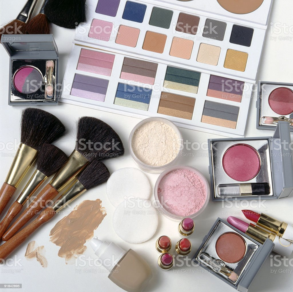 Overhead view of colorful make-up items on a white surface royalty-free stock photo