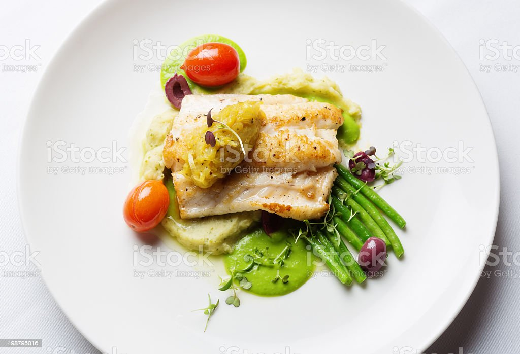 Overhead view of healthy and delicious grilled fish restaurant dish stock photo