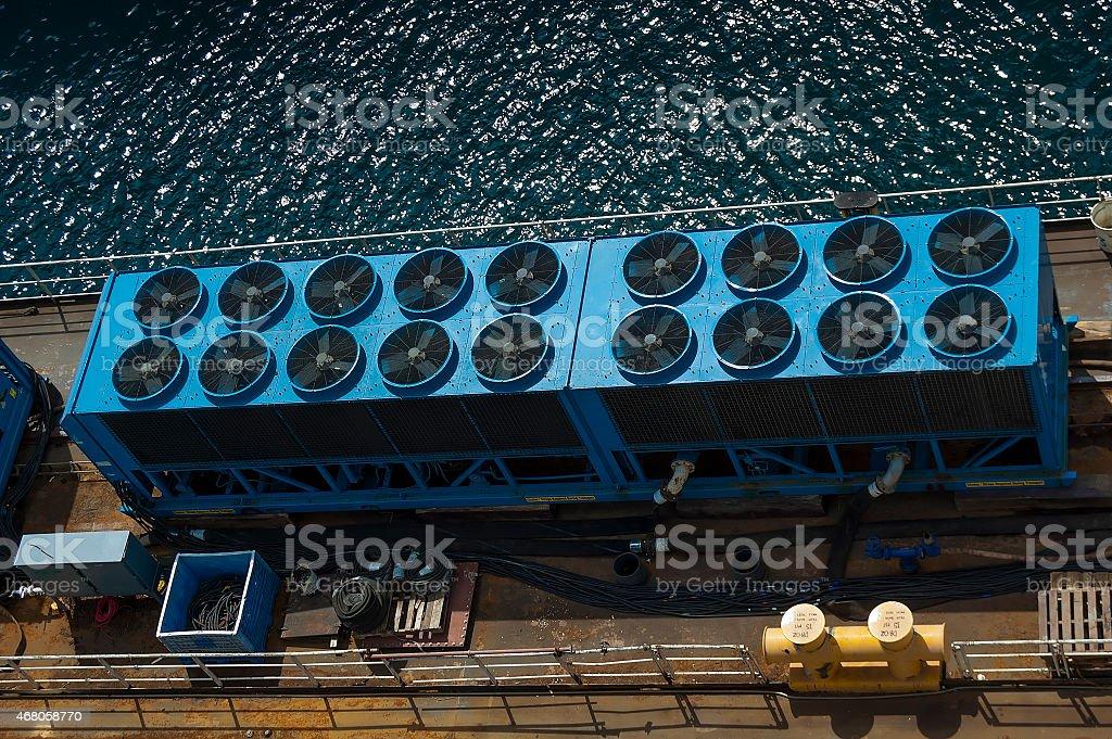 Overhead view of industrial equipment on dock stock photo
