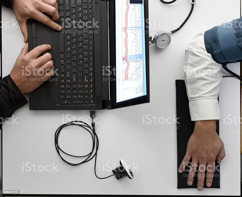 Overhead view of lie detector test stock photo
