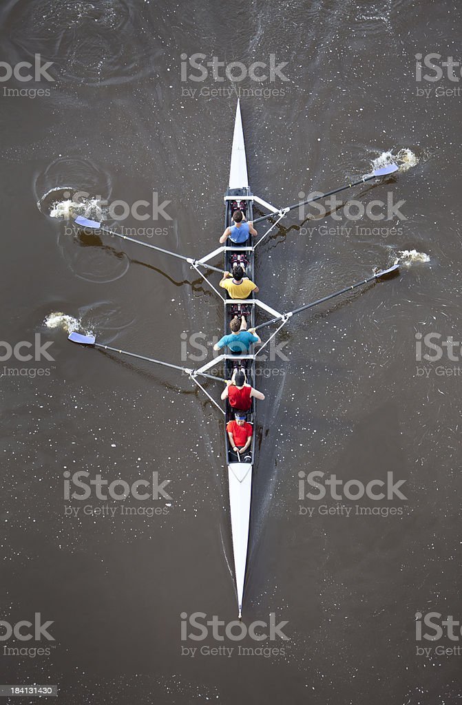 Overhead View of Men Rowing a Four Person Scull. royalty-free stock photo