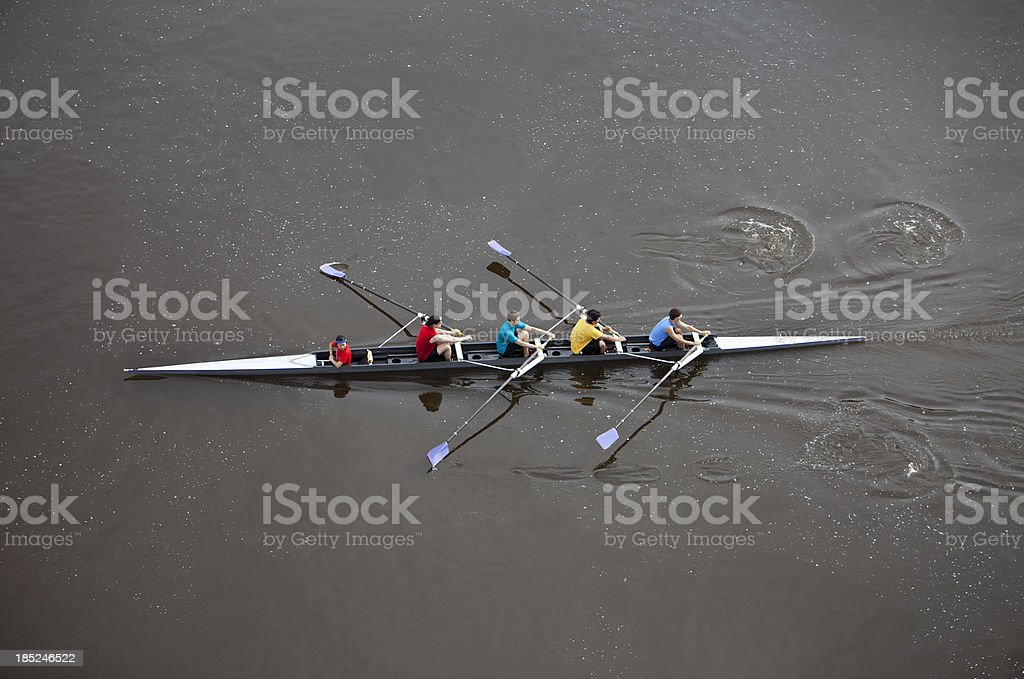 Overhead View of Men Rowing a Four Person Scull. stock photo
