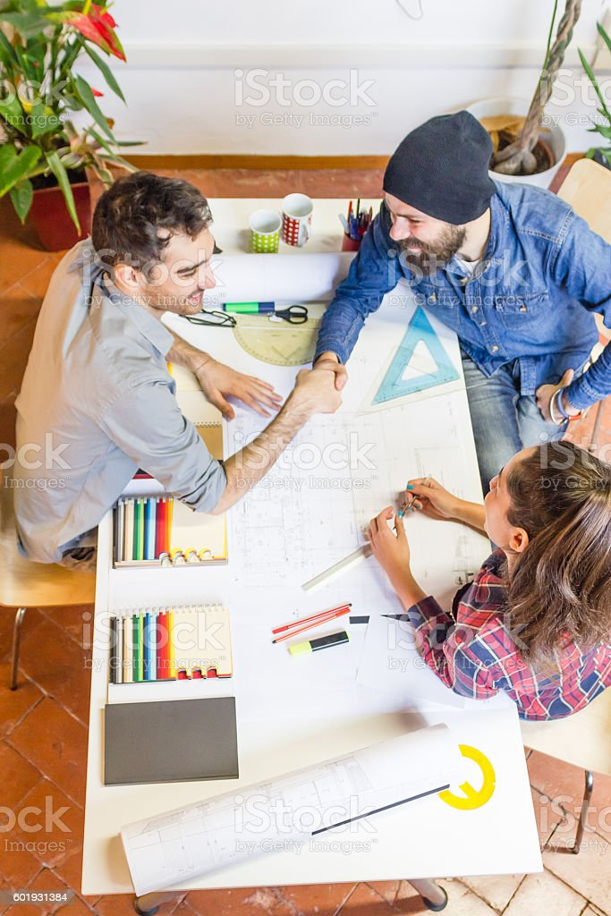 overhead view of people working together from above stock photo