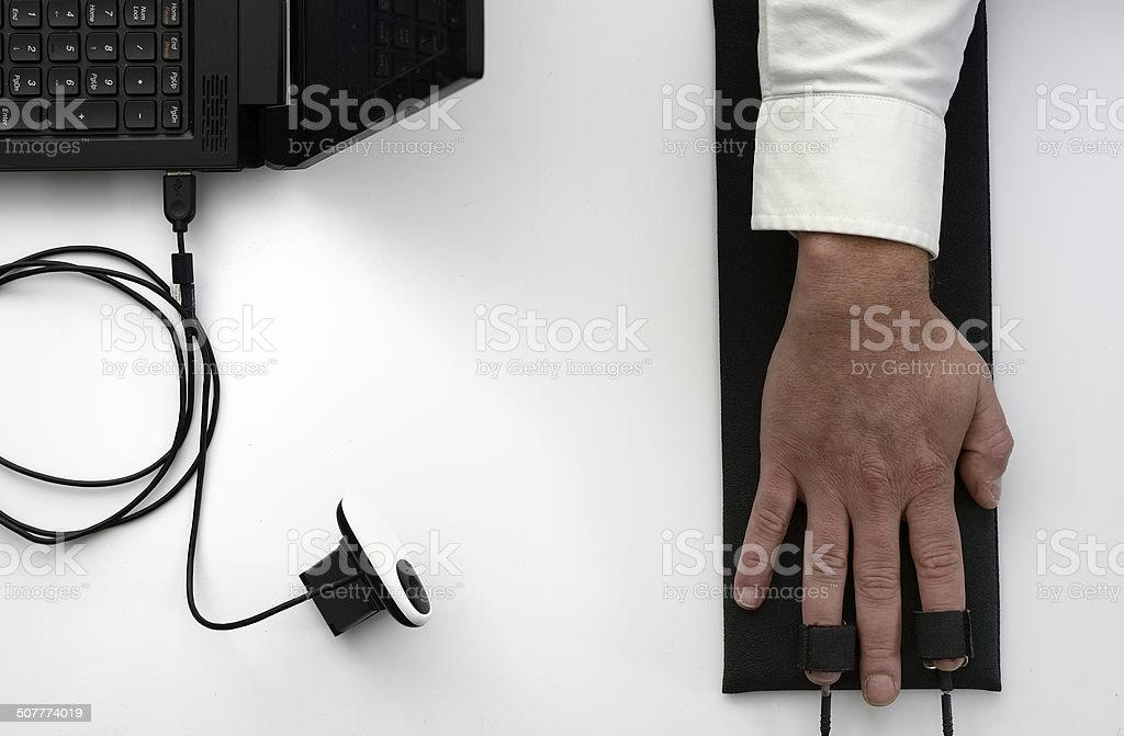 Overhead view of polygraph finger sensors and camera stock photo