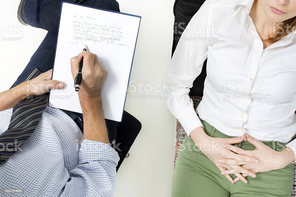 Overhead view of psychiatrist talking to patient royalty-free stock photo