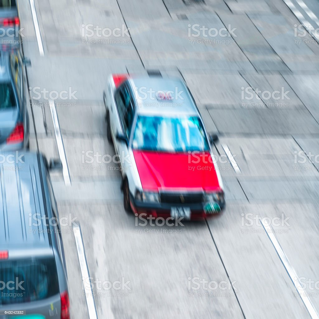overhead view of red taxi driving on city road stock photo