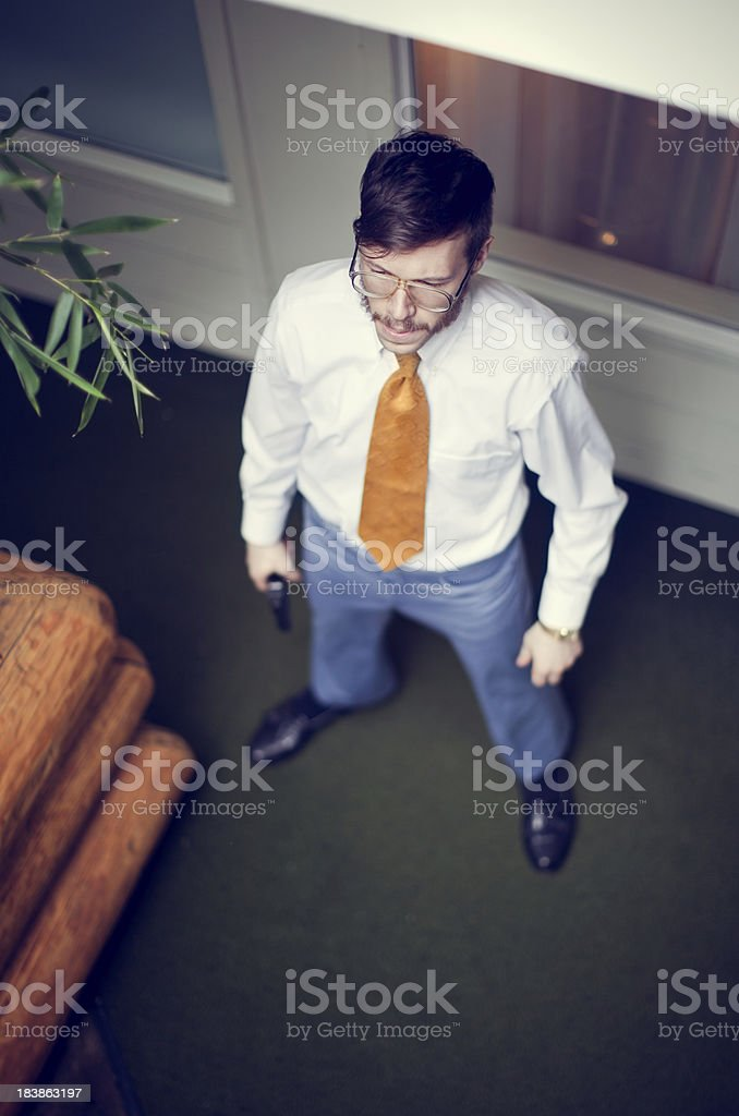 Overhead View of Retro Secret Agent Waiting with Pistol royalty-free stock photo