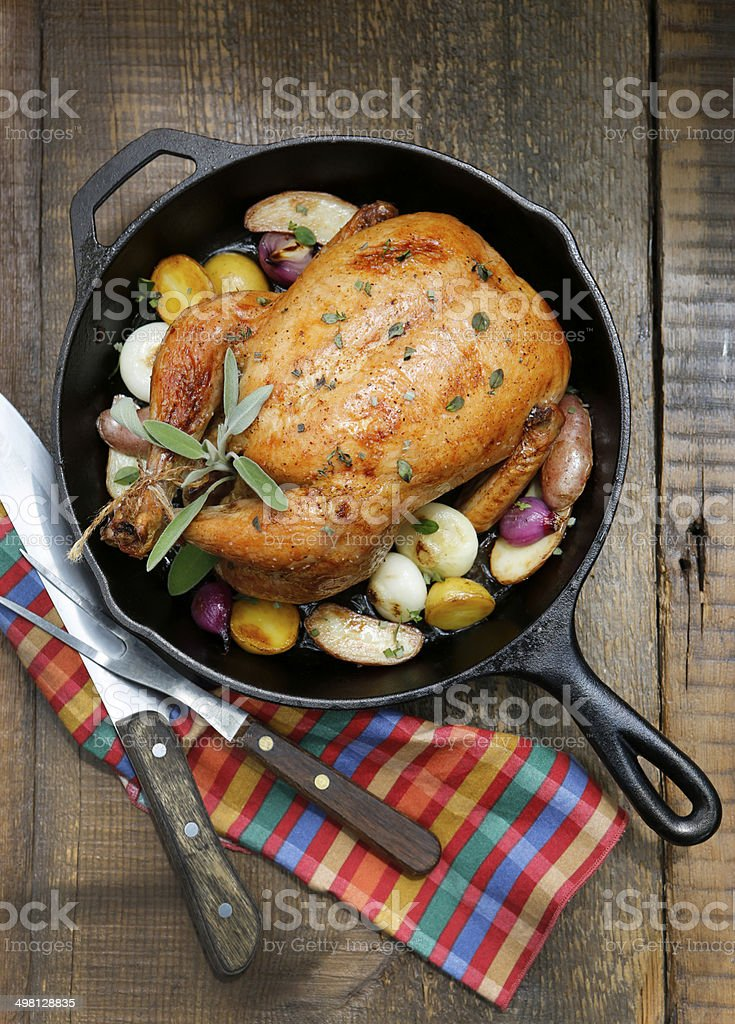 Overhead View of Roast Chicken with Vegetables and Sage. stock photo