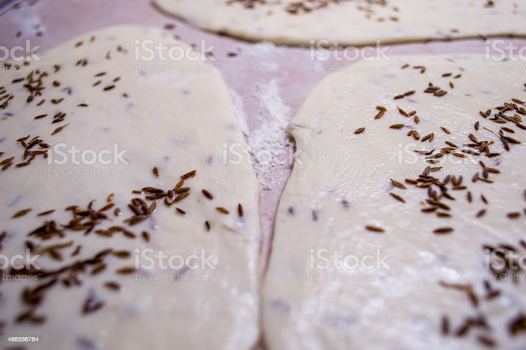 Overhead View of Rolled Flatbread/Bread Dough Garnished with Caraway Seeds royalty-free stock photo