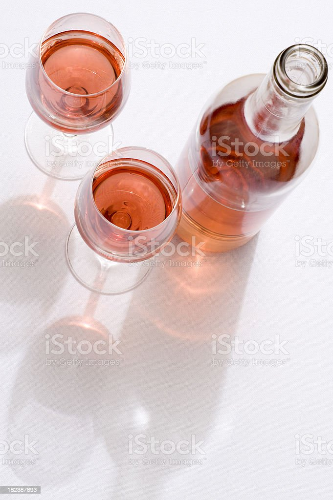Overhead view of rose wine on white tablecloth royalty-free stock photo