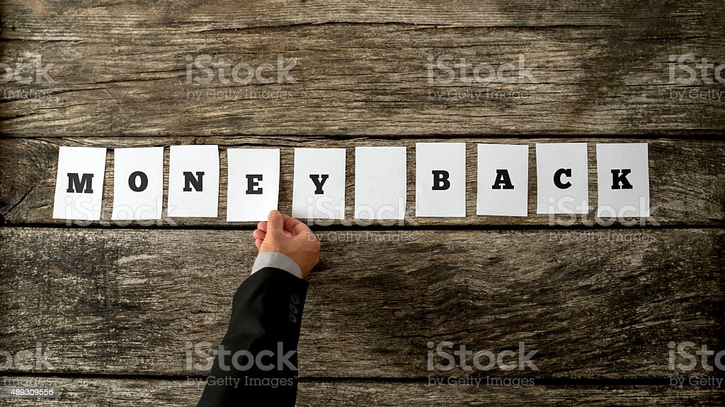 Overhead view of salesman assembling a sign Money back stock photo