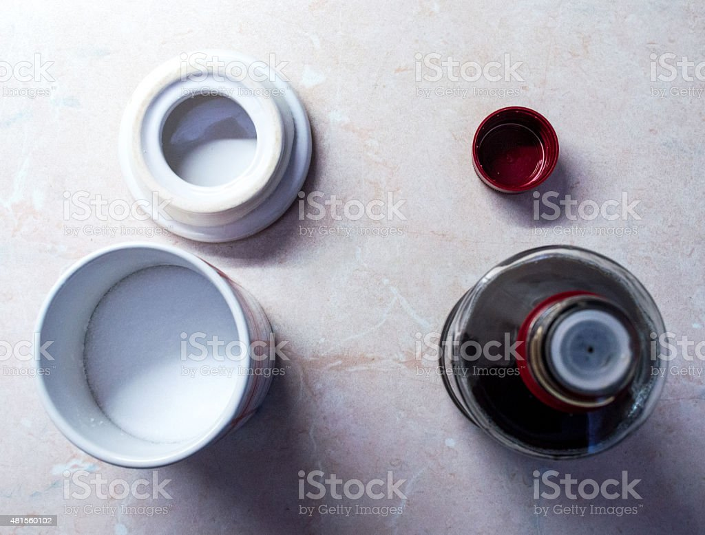 Overhead View of Salt Container and Vinegar Bottle royalty-free stock photo