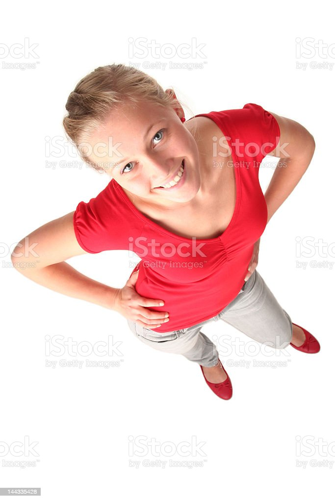 Overhead view of smiling blonde woman looking up at camera royalty-free stock photo