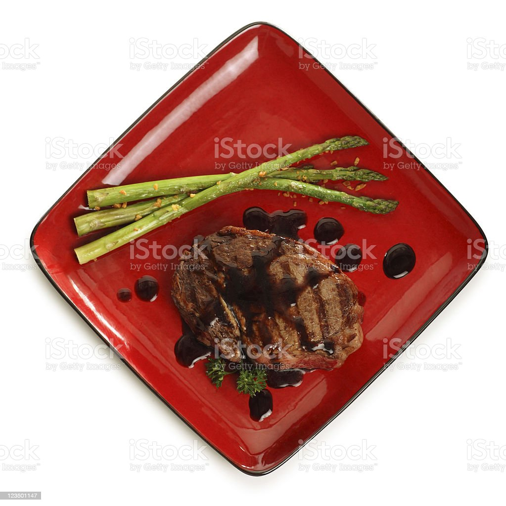 Overhead view of Steak on a Red Plate royalty-free stock photo