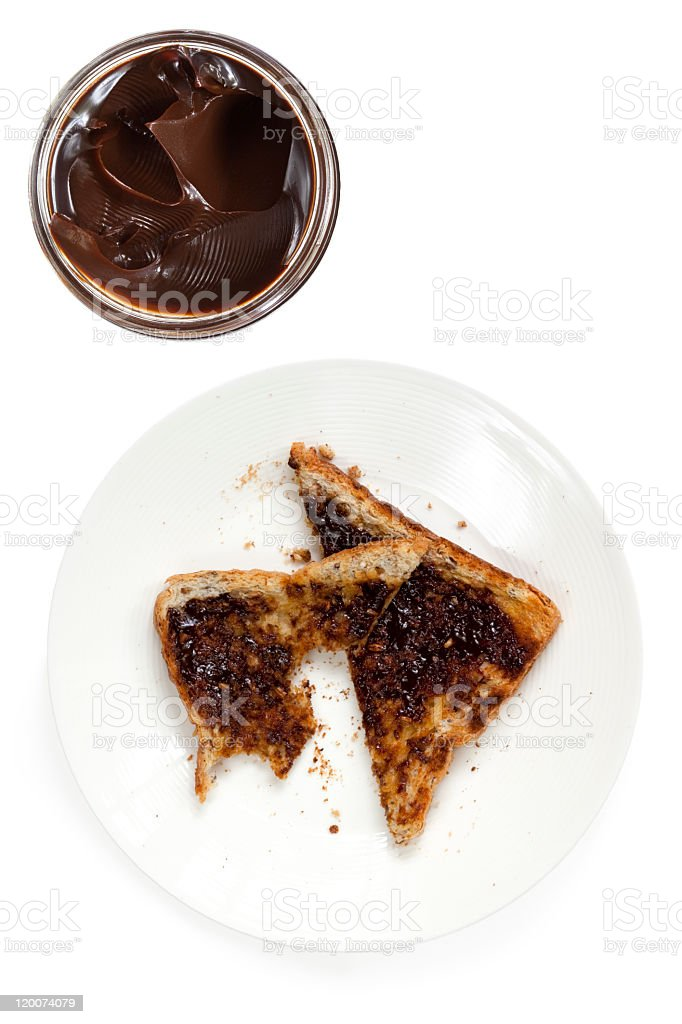 Overhead view of toasted bread with chocolate spread stock photo
