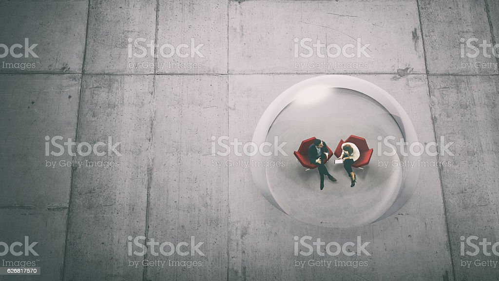 Overhead view of two business persons in a glass sphere stock photo