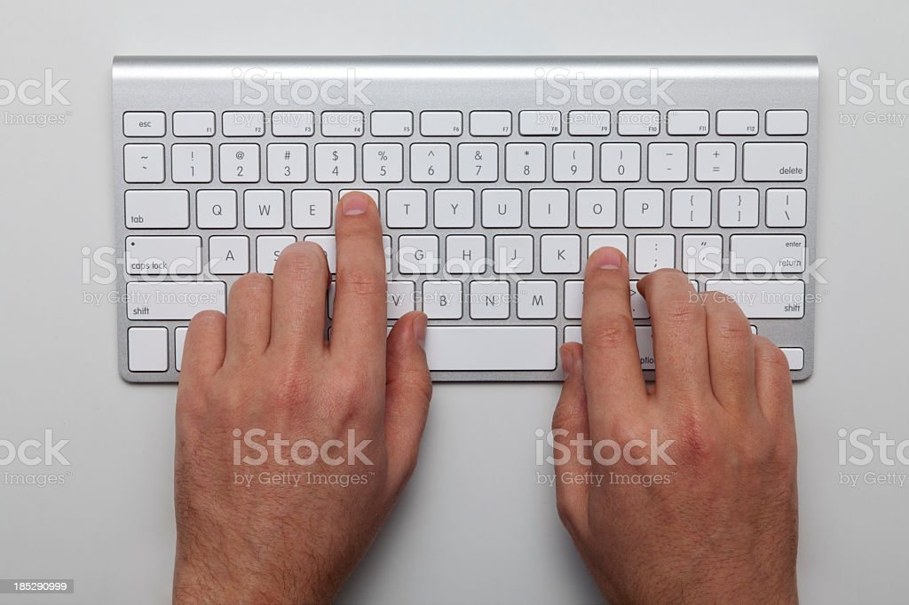 Overhead view of two hands on a keyboard royalty-free stock photo