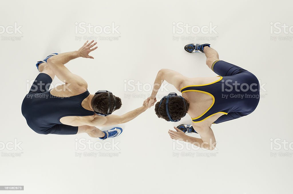 Overhead view of two men wrestling royalty-free stock photo