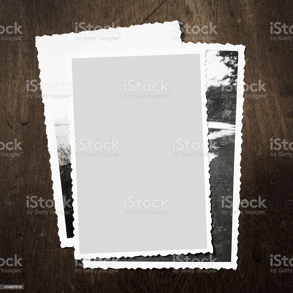 Overhead view of vintage family photos on wooden background stock photo