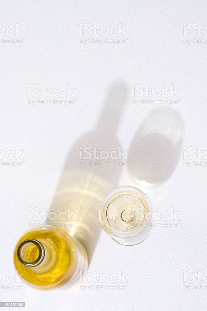 Overhead view of wine bottle and glass with their shadows stock photo
