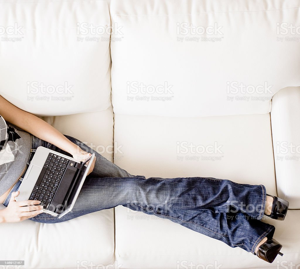 Overhead View of Woman on Couch With Laptop royalty-free stock photo