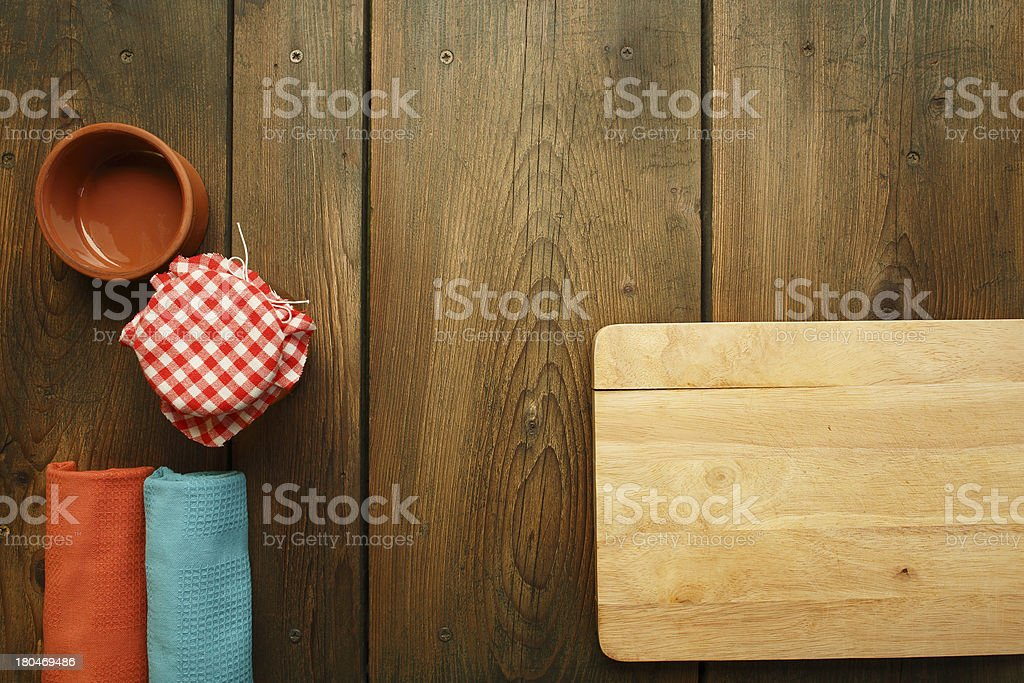 Overhead view of wooden kitchen table with accessories royalty-free stock photo