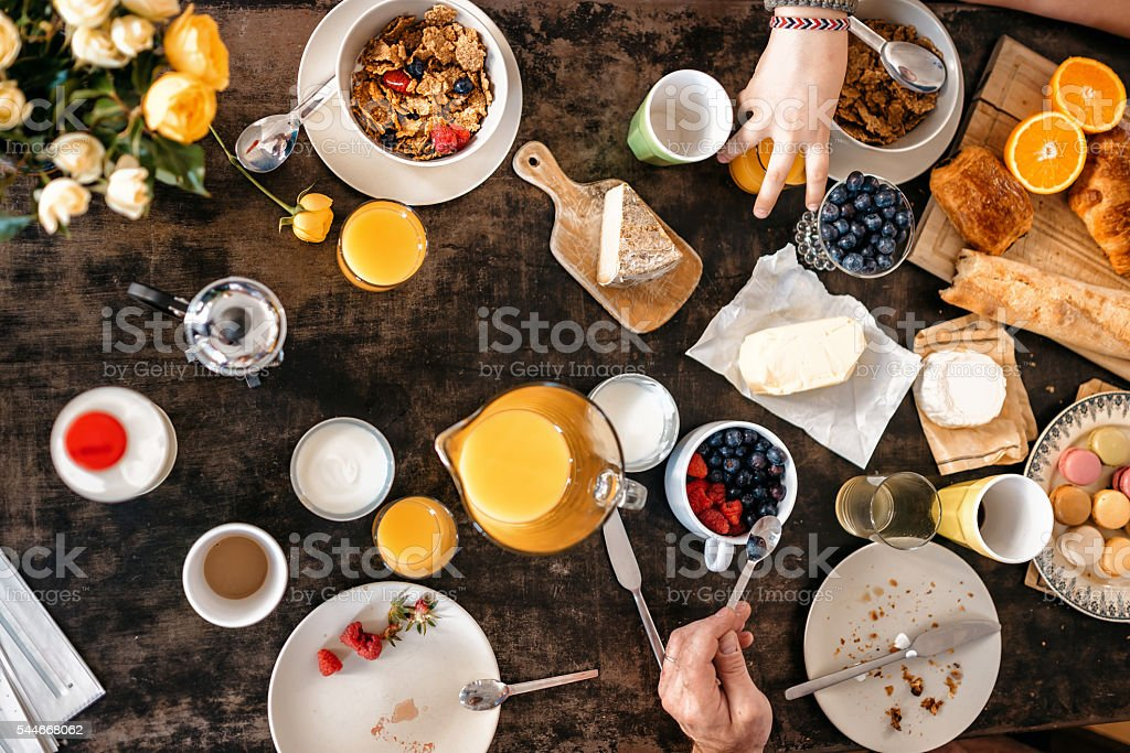 overhead view on  french breakfast table with macarons and baguette stock photo