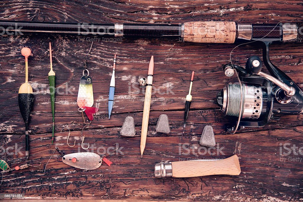 overhead view on old fishing equipment on wooden plank stock photo