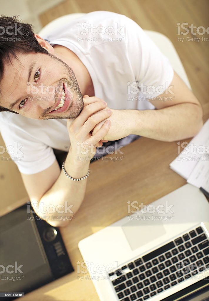 Overhead View Smiling Man At Laptop royalty-free stock photo