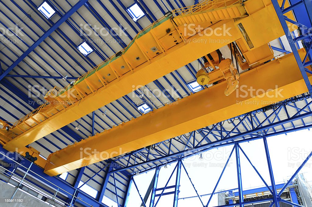 Overhead yellow crane in industrial scenery stock photo