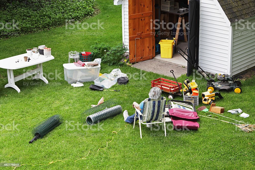 Overheard view of woman taking a break from spring cleaning stock photo
