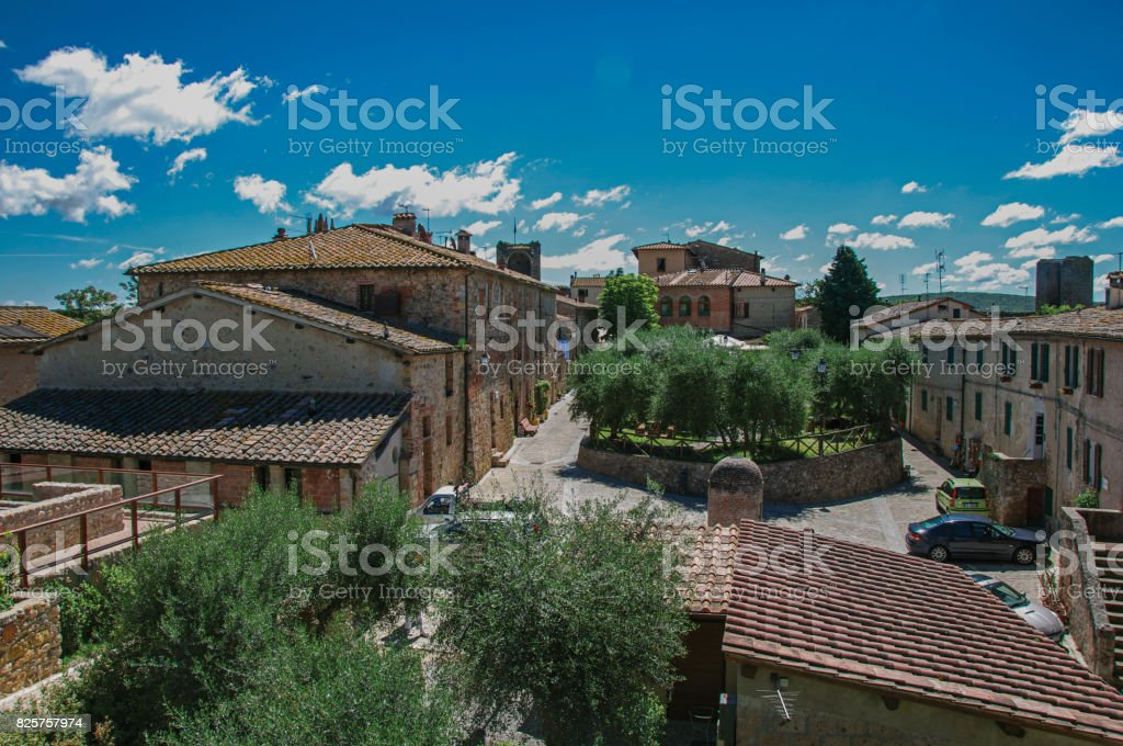 Overiew of buildings and trees in the city center of the Monteriggioni hamlet. stock photo