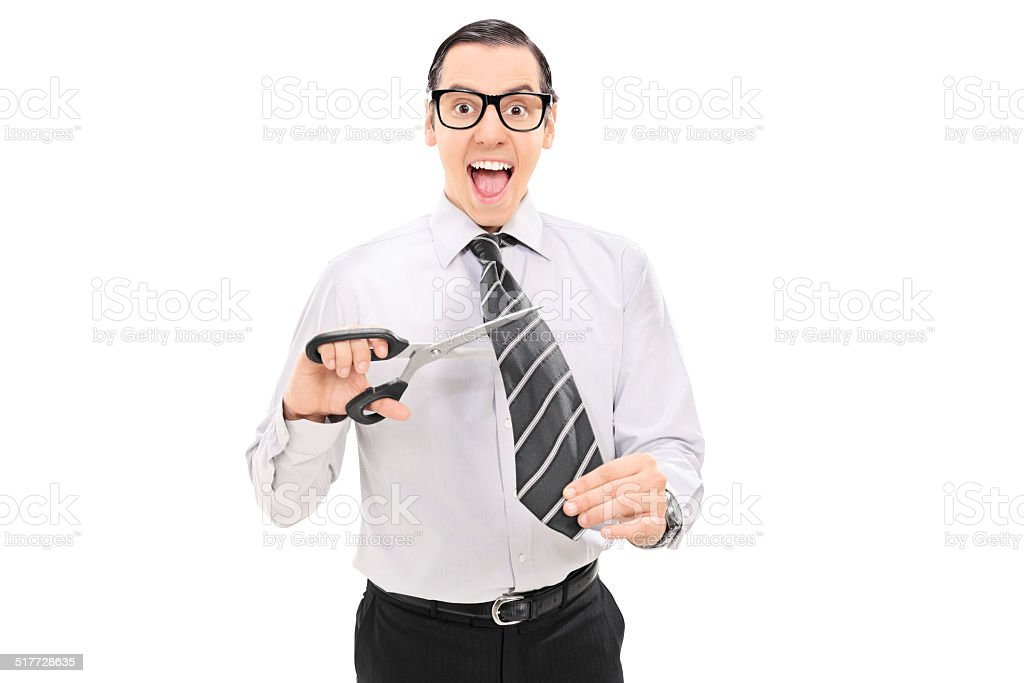 Overjoyed man cutting off his tie with scissors stock photo
