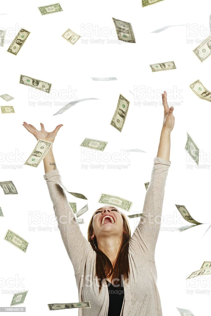 Overjoyed woman catching shower of falling banknotes stock photo
