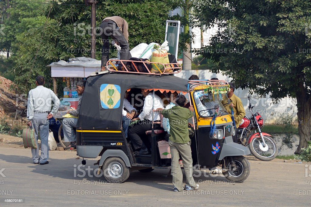 overloaded auto rickshaw stock photo