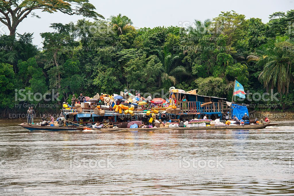 Overloaded barge (vessel) on the Congo River stock photo