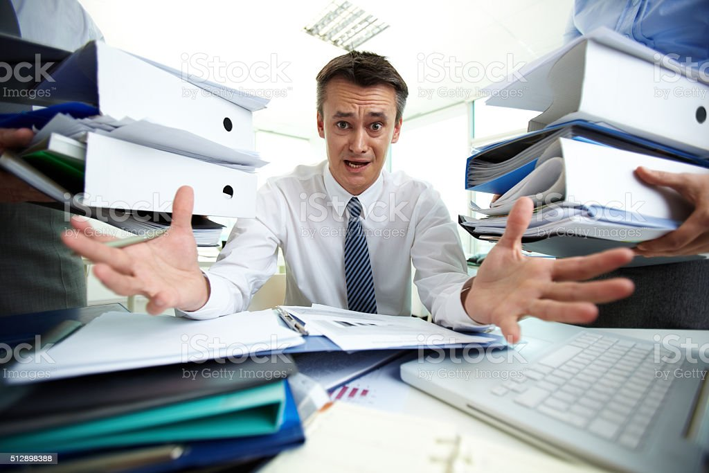 Overloaded with paperwork stock photo