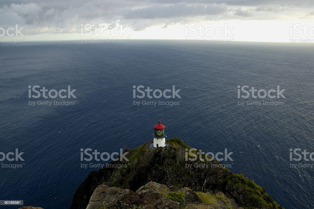 Overlooking a lighthouse and the Pacific Ocean during a stormy s stock photo