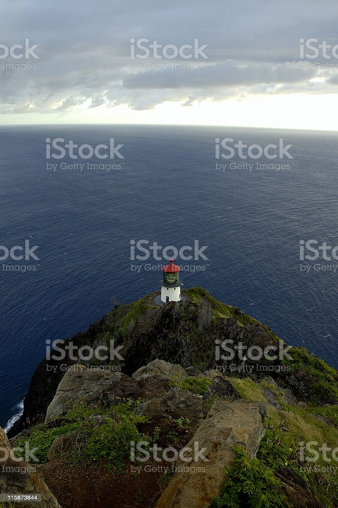 Overlooking a lighthouse and the Pacific Ocean stock photo