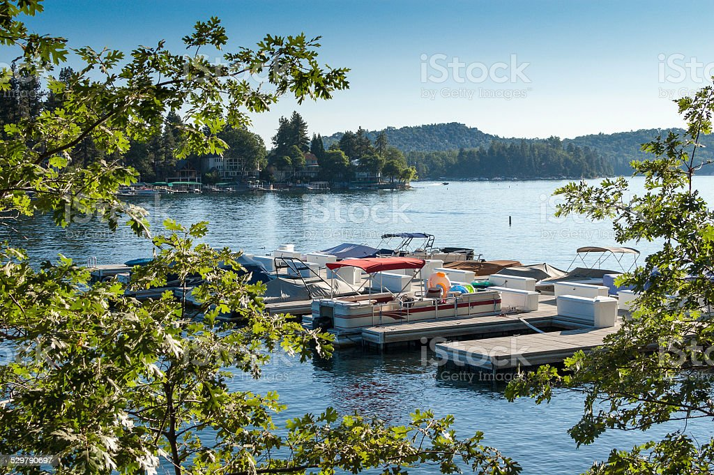 Overlooking a pier and boats on Lake Arrowhead, CA stock photo